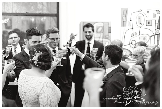 orange-art-gallery-wedding-stephanie-beach-photography-reception-guests-toast