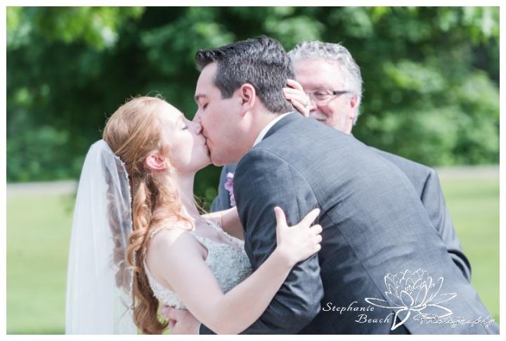 Rideau-View-Golf-Course-Wedding-Stephanie-Beach-Photography-first-kiss