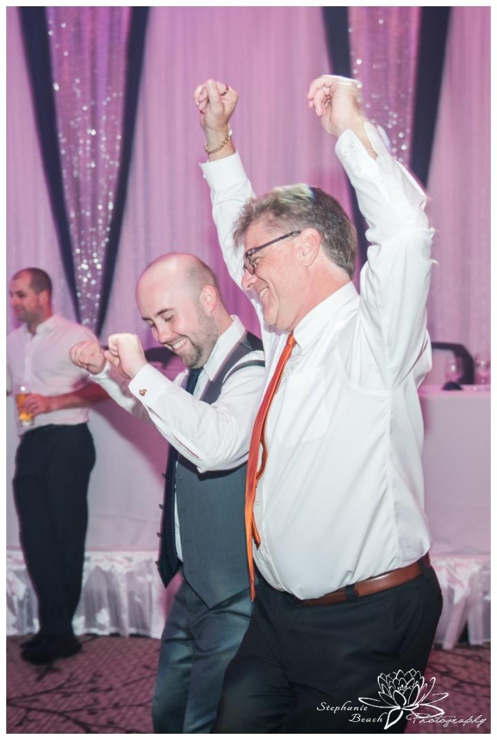 Infinity-Centre-Ottawa-Wedding-Stephanie-Beach-Photography-reception-dancing-groom