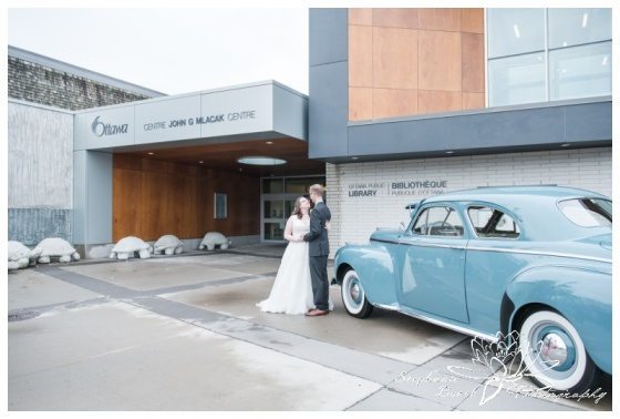 Ottawa-Public-Library-Wedding-Stephanie-Beach-Photography-bride-groom-portrait-car-exterior